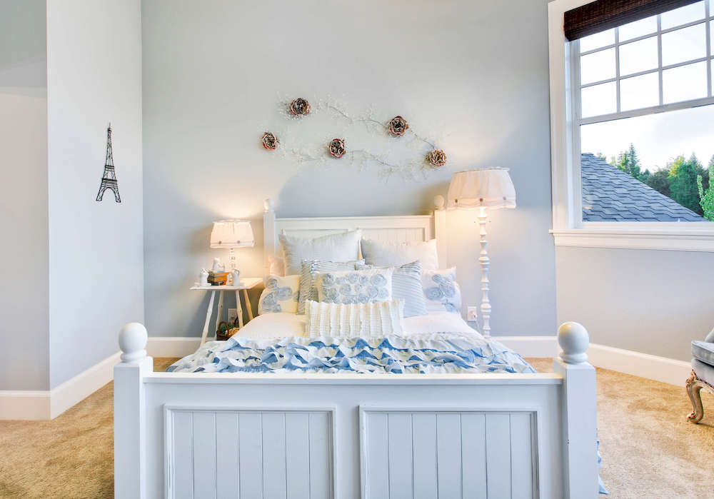 blue kids room with blue bed and wallpaper