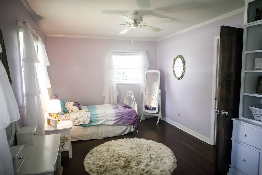 lavender kids room with carpet, ceiling fan and bed